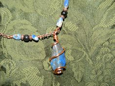 Lapiz Wire Wrapped Necklace. $25.00, via Etsy. Unique Handcrafted Jewelry created by me. :)  Created from beads, wire, ribbon, and charms.  <3  Creative, interesting, and fun to wear!