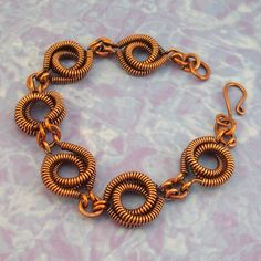 Bracelet:  Copper, Antiqued.  I learned this technique many years ago in a class taught by Jeanette Blix Ryan.  It continues to be one of my favorites, even if it does take hours to create.
