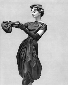 Monique Chevalier is wearing a dress by Grès, hat by Rose Valois, jewellery by Scémam and a handbag by Francis Winter, 1957. Photo by Georges Saad