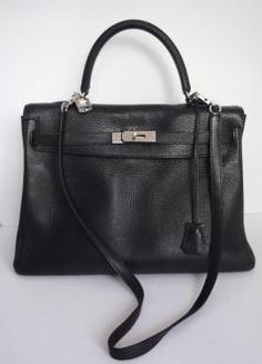 This is an authentic HERMES Togo Kelly 35 in Noir Black. This ...