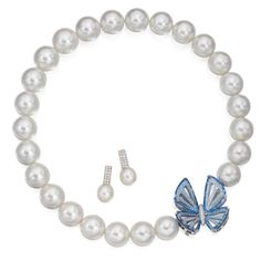 Cultured Pearl, Diamond and Blue Topaz Necklace and Earrings The necklace composed of 25 cultured pearls measuring approximately 18.0 to 16.0 mm, completed by a clasp in the form of a blue topaz butterfly, length 18 inches, the clasp signed Paspaley; the butterfly detaches for wear as a brooch; together with one loose cultured pearl to take the place of the butterfly when detached; the earclips supporting two cultured pearls measuring approximately 12.0 to 11.0 mm, with diamond-set tops…