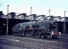 34013 'Okehampton' stands in the largely deserted Salisbury MPD on a hot summers weekend in steam.Presumably as a Standby for the Mainline in case of a failure. 14 august 1966