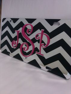 Beautiful #chevron and #monogrammed #pink and #black graphics on a silver mirror license plate we shipped off to a web customer. We offer a wide variety of original yet #custom car tags on our mobile friendly site