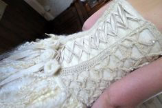 Wedding Dress bodice and skirt, showing Lincoln Longwool used in several different ways – as hand spun, crocheted lace and as long shiny locks!