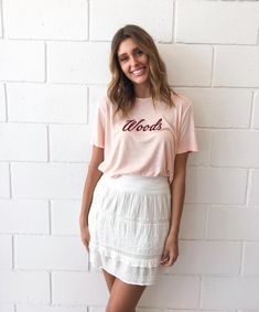 Inspired by vintage sports logo T's this seasons signature WOODS T features a boyfriend silhouette & cursive embroidered logo. Made from a luxe linen blende