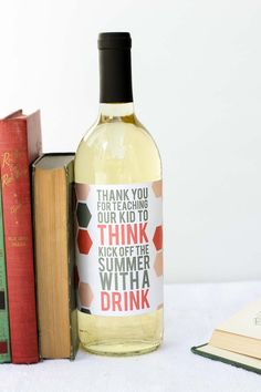 "What better way to say ""thank you"" to a teacher at the end of the school year than with a little wine present? This free wine label printable makes an easy, yet memorable DIY teacher appreciation gift. Click to download the free printable. 