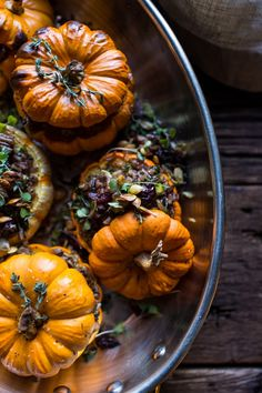 Nutty Wild Rice and Shredded Brussels Sprout Stuffed Mini Pumpkins, so cute AND delicious! Perfect for your Thanksgiving table, from halfbakedharvest.com