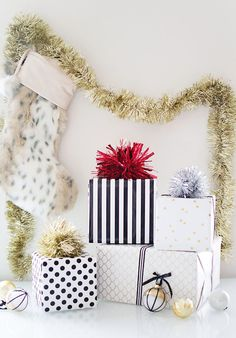 DIY tinsel pom pom gift toppers // this is the perfect holiday gift wrap how-to! #christmas