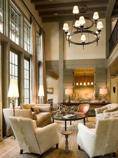 aspen living room by mcalpine tankersley...love those shutters between the living and kitchen...love, love