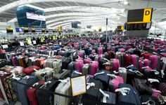 FILE - In this May 2012 file photo released by British Airports Authority, over pieces of baggage are seen lined-up in Terminal 5 at Heathrow Airport during a baggage handling exercise to prepare for the Olympic games. Travel Advice, Travel Tips, Air Travel, British Airports, Airport Luggage, Cheap Flight Tickets, Heathrow Airport, Pictures Of The Week, Best Budget
