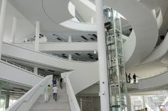 A variety of white wall staircases in an atrium.