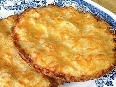 ALMOND CHEESE ROUNDS  4 ounces cheddar cheese, shredded (1 cup)  3 ounces almond flour (1 cup)  2 tablespoons butter, softened  1 egg  1/2 teaspoon garlic powder  1/4 teaspoon salt    Mix all of the ingredients well with a spoon until they form a soft dough. Divide between 6 muffin top pans and press to make flat rounds. Bake at 350 about 10-12 minutes until golden brown.