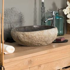 Offer a relaxing and relaxing atmosphere in your bathroom with the natural pebble stone basin! Stone Basin, Pebble Stone, Bathroom Vanity Units, Vanity Sink, Natural Stone Countertops, Diy Snacks, Stone Bathroom, Sink Countertop, Metal Furniture