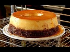 Delicious and decadent, the first layer is a hybrid of flan and cheesecake and the second layer is a rich chocolate cake. Super easy to make, this cake will . Bolo Flan, Flan Cake, Mexican Food Recipes, Sweet Recipes, Cake Recipes, Dessert Recipes, Food Cakes, Cupcake Cakes, Köstliche Desserts