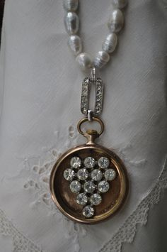Fabulous pendant made from a vintage watch, pin, pearls and bracelet linc....