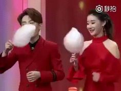 Female presenter destroys male co-host in cotton candy eating contest