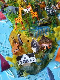 Sara Drake - Southern Africa detail from large 3D world map. Maps are made from mixed media, including papier mache, balsa wood, acrylic paint, beads and wire. All details are hand made and to commission. Each map is personalised with the details of the client's own travels.