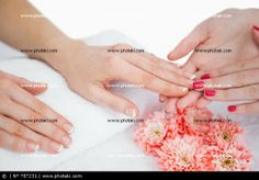 http://www.photaki.com/picture-close-up-of-woman-getting-manicure-done_787231.htm