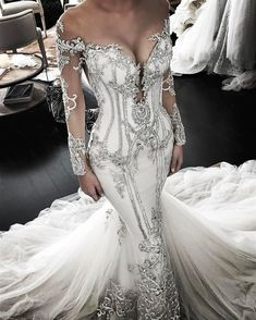 This sexy long sleeve bridal dress is a haute couture masterpiece. The detail with beading and embroidery is amazing. Unfortunately the cost of this haute couture design is out of many brides price ranges. But as custom dressmakers we can help. We are in Dallas Texas and can make very close #replicas of haute couture design that will look very similar but cost way less. So if your dream gown is out of your price range email us a picture from our website at www.dariuscordell.com