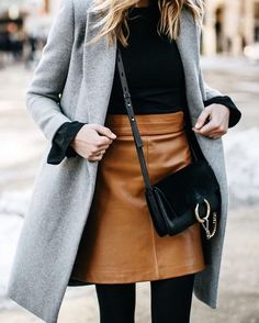 Black blouse with a brown high rise leather skirt and grey coat with black tight. fashion coats Black blouse with a brown high rise leather skirt and grey coat with black tight.