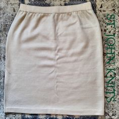 "St. John Knits Pencil  Skirt Gorgeous creamy color. Excellent pre owned condition. Waist 14"" hips 19"" length 20.5"". St. John is known for its stretch and ability to fit and flatter at least  1 size up. St. John Skirts Pencil"