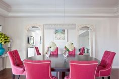 These chairs would make anyone smile and the mirror on the wall brings more interest to this dining room.