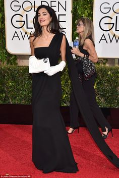 Mrs Clooney looked glamorous in her long, flowing black Dior dress and long, white gloves