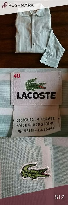 Lacoste men's shirt Very nice men's long sleeve lacoste shirt, size 40 which is a   very small mark on top crease of shoulder... size of ink pen tip... which is really small.. see pic.. lacoste  Shirts Casual Button Down Shirts