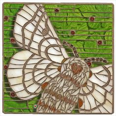 "https://flic.kr/p/bEwu7j | 'Bombyx Mori'  Artist: Cherie Bosela | Size: 6.25""x6.25""  Tesserae: stained glass, millefiori, seed beads, gem stone beads, glitter and photograph (mulberry tree leaves)   I chose the Bombyx mori moth (latin for silkworm of the mulberry tree) because it is used in traditional Chinese medicine to heal.  So I thought it was fitting for this charity auction.   Artist Statement:   I am inspired by the flowers, plants and creatures that Mother Nature has produced.  I…"