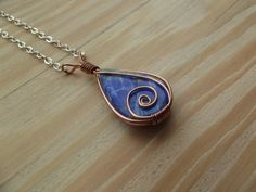 Premium copper wire wrapped lapis lazuli pendant from WorldTreeArtifacts on Devian . - Premium Copper Wire-Wrapped Lapis Lazuli Pendant from WorldTreeArtifacts on DeviantArt This image ha - Rock Jewelry, Metal Jewelry, Jewlery, Wire Wrapped Necklace, Wire Wrapped Pendant, Lapis Lazuli Pendant, Diy Jewelry Inspiration, Wire Pendant, Wire Weaving