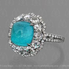 Leon Mege continues to make the most amazing pave platinum settings I have ever seen: a staggering sugarloaf Paraiba tourmaline accented with rose and full cut diamonds