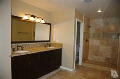 All bathrooms have new travertine tile on floors and in showers, gorgeous new granite countertops, new vanities and all new fixtures