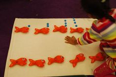 This is an adorable idea.  1-10 on the fish and blue counters (buttons?) as bubbles ;)