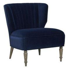 Arietta Chair - Plush wingback repose with the élan of a slipper chair. Luxurious deep blue velvet upholstery pleats elegantly across the ba...