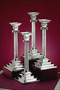 "A perfect illustration of the Georgian ""Rule of Taste"" Candlesticks  Emblem of the Wallace Museum, these silver candlesticks were made by Paul de Lamerie in mid-eighteenth-century London. The classical symmetry and simplicity of form reject the ornateness and complexity of the baroque and rococo.  Smaller in size but equally impressive in quality is a set of four candlesticks made by the renowned silversmith Paul de Lamerie in London in the mid-1740s."