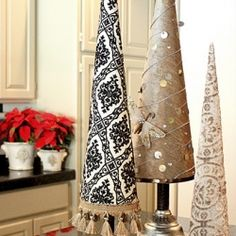 Tutorial for easy and beautiful fabric covered poster board Christmas tree cones.