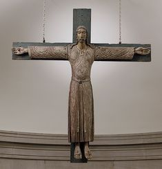 Rather than emphasizing his pain and suffering on the cross, this image presents Christ in glory, alive, eyes wide open. He wears a full-length robe connoting his kingly and priestly rank. This type of crucifix is known as the Volto Santo (Holy Face) St Leo The Great, Sign Of The Cross, Catholic Priest, Roman Catholic, British Royal Families, Medieval Art, Sacred Art, Religious Art, Religious Wedding