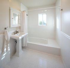 Subway tile bath surround, beadboard around the bathroom, and octagon floor