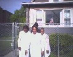 This photo was taken the day of these three ladies mother's funeral. There in the picture is a dark figure of a man standing  behind the middle woman resting his right hand on her right shoulder... coincidentally the woman was killed in a car accident not    long after this picture was taken.