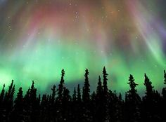 Good ole northern lights and southern lights, both visible 65 to 72 degrees north and south latitudes respectively, are actually just natural light shows that e