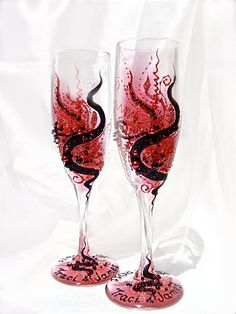 kinda expensive but i love these personalized red and black wedding champagne flutes. $52.00, via Etsy.
