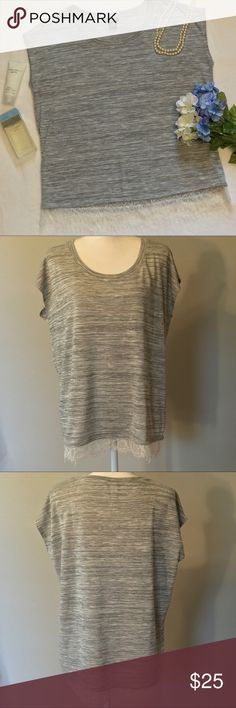 "Torrid grey lace hem blouse Torrid grey lace hem blouse. Sleeveless top with delicate white lace hem. EUC, excellent used condition. Size 00= size 10. 23"" bust, 27 1/2"" length. torrid Tops Blouses"