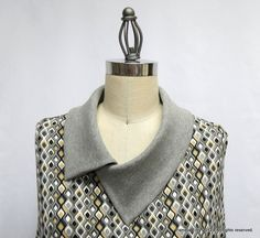 sewingitnow:  The split cowl collar - step by step tutorial  Great way to instantly change the look of a rounded neckline.