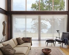 Hunter Douglas Luminette Privacy Shades A Contemporary Neutral Palette And Enlarged Windows Uplift This Room With The Light Filtering Style Of