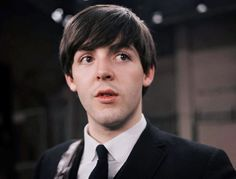 Paul McCartney, 21 years old, on the set of the Ed Sullivan Show with the Beatles, on February 9, 1964.