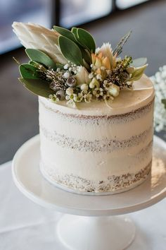 Semi naked single tier rustic wedding cake with Australian native flowers | Bless Photography