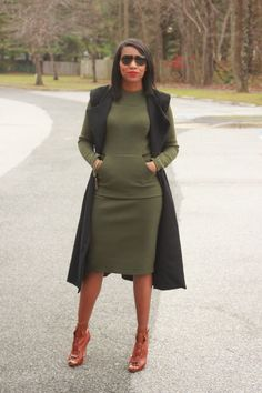 black sleeveless coat and green dress