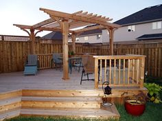 Here we have a casual styled pergola with a higher deck. The actual; size and space of pergola is smaller. There is provision of open roof less space on the deck. The sitting arrangement has been kept casual, simple and portable to move anywhere on the deck. The wooden fence allows privacy and security.