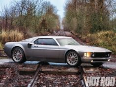 """Mach 40 - 1969 Ford Mustang. WAT!? """"How would a fastback '69 Mustang look if it morphed to the proportions of the world-beating, mid-engine GT40?"""" + """"Terry plans to drive the car at speed, and the pressure of the air in the hatch might be high enough to pop out the back window if the vents are left open."""" Daaaaang. I'm pretty sure I dig this."""