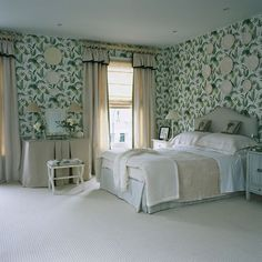 Ferns cover the walls of this bright and cheery bedroom in brilliant green and crisp white.